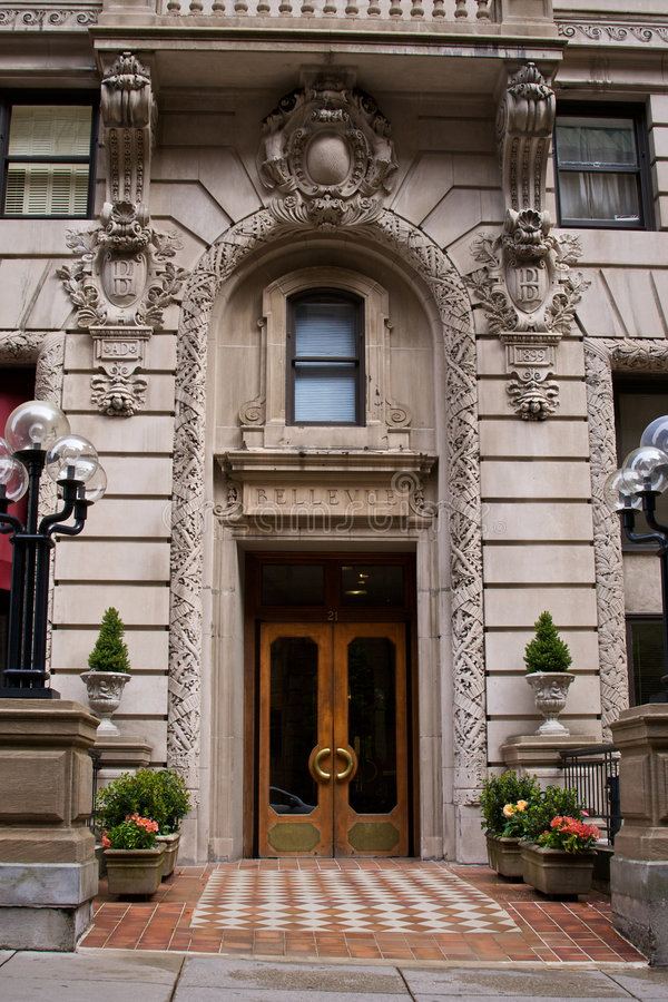 Bellevue. Ornate carvings and front doors to the 19th century bellevue hotel on beacon street in boston massachusetts royalty free stock photography