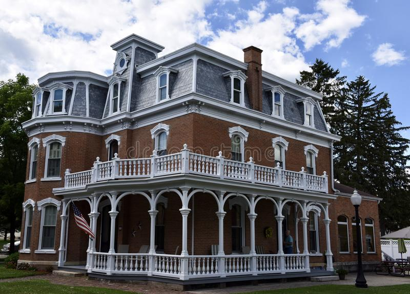 Bellevue Italianate. This is a Summer picture of a house located in Bellevue, Iowa in Jackson County. This example of Italianate architecture features a Mansard stock photography