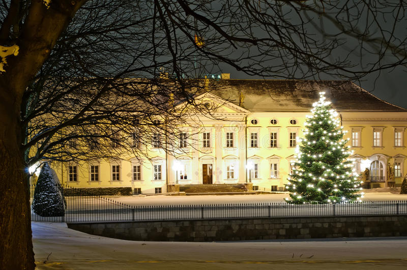 Bellevue palace in berlin. In winter at night with christmast tree stock images