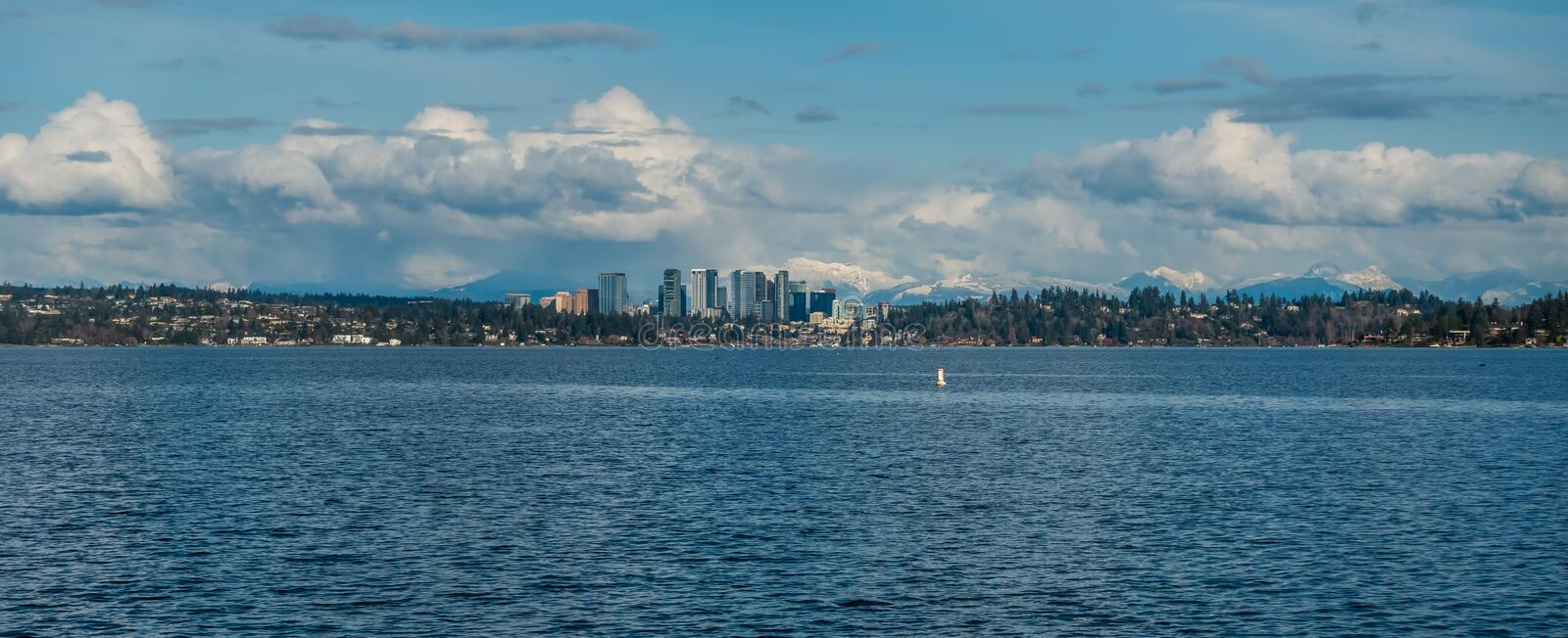 Bellevue Skyline and Cascades Panorama 2. Panorama shot of the skyline of Bellevue, Washington with the Cascade Mountains behind royalty free stock images