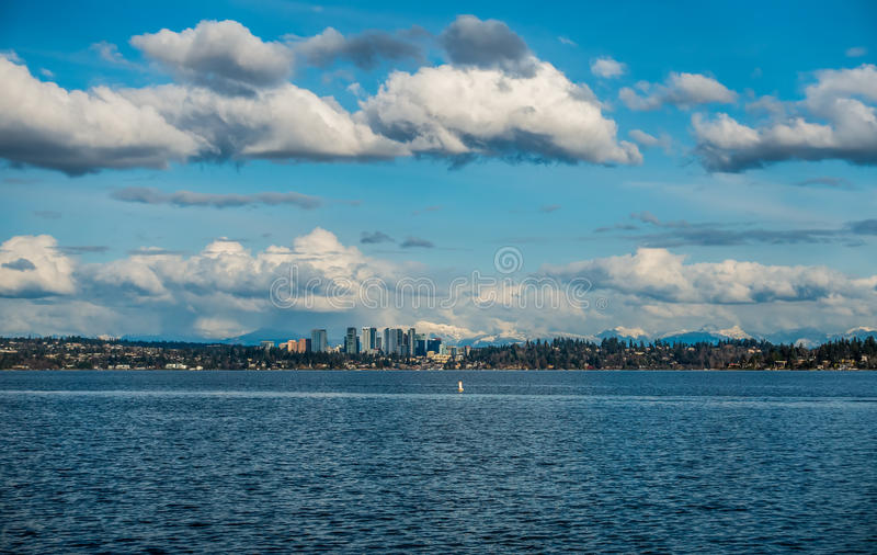 Bellevue Skyline and Cascades. A view of the skyline of Bellevue, Washington with the Cascade Mountains behind royalty free stock image
