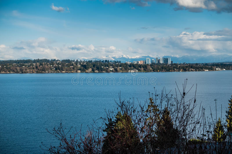 Bellevue Skyline and Mountains. A view of the skyline of Bellevue, Washington with the Cascade Mountains behind stock photo