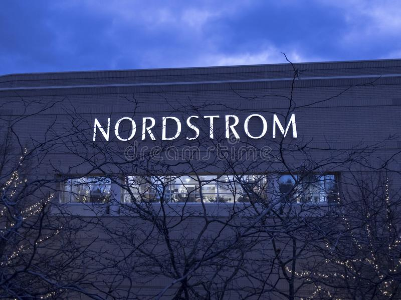 Night view of the Nordstrom clothing store sign from a parking garage rooftop. Bellevue, WA / USA - circa November 2019: Night view of the Nordstrom clothing stock photo