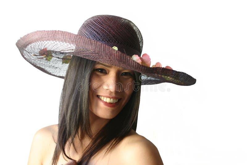 Belleza asiática con el sombrero foto de archivo