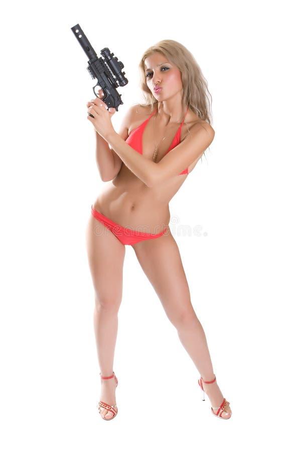 Belleza con el arma foto de archivo