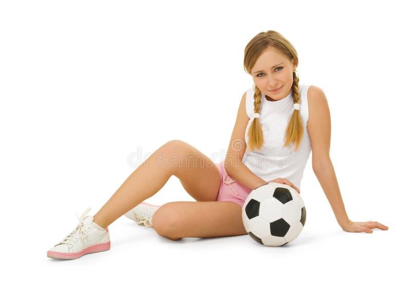 Belleza con el balón de fútbol fotografía de archivo libre de regalías