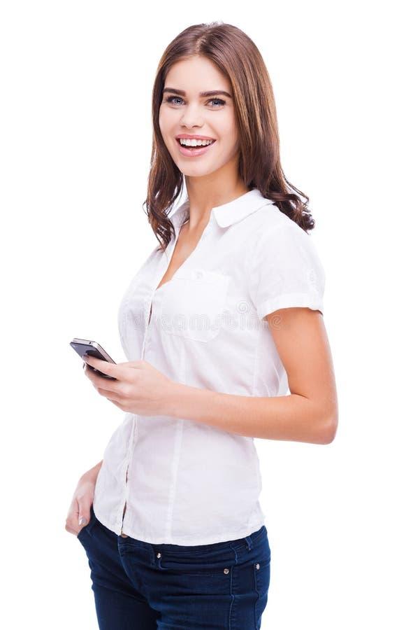 Belleza con el teléfono móvil fotografía de archivo