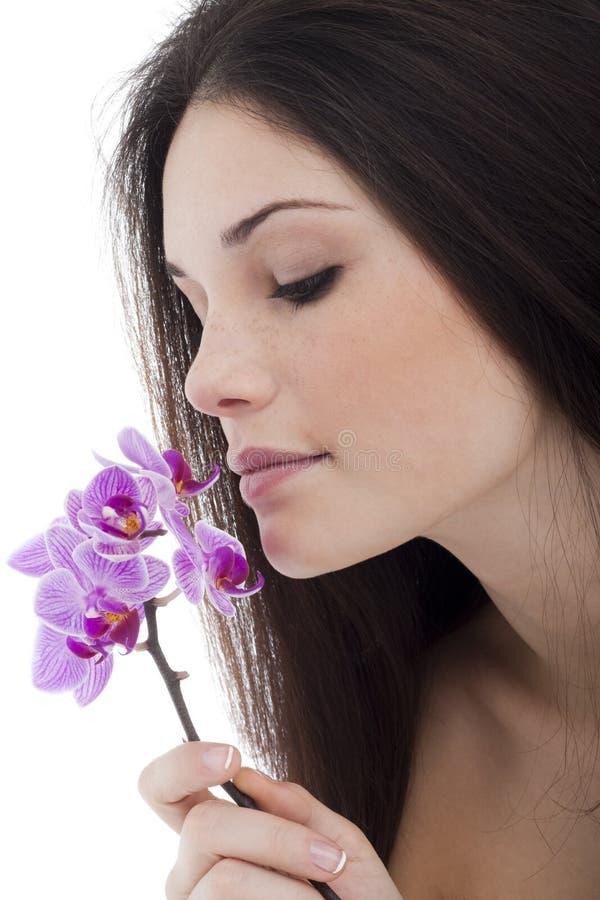 Belleza con la orquídea foto de archivo libre de regalías