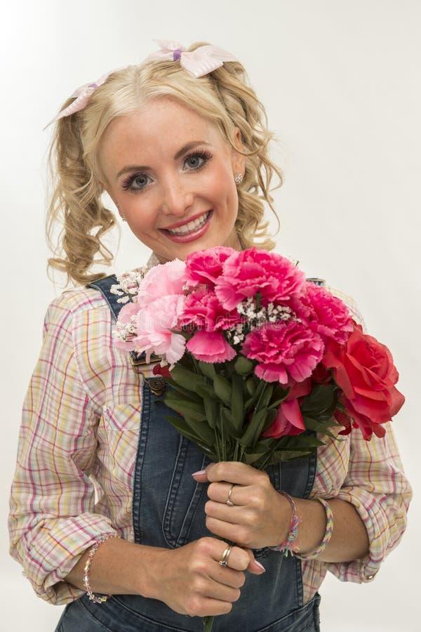Belleza con las flores fotos de archivo libres de regalías