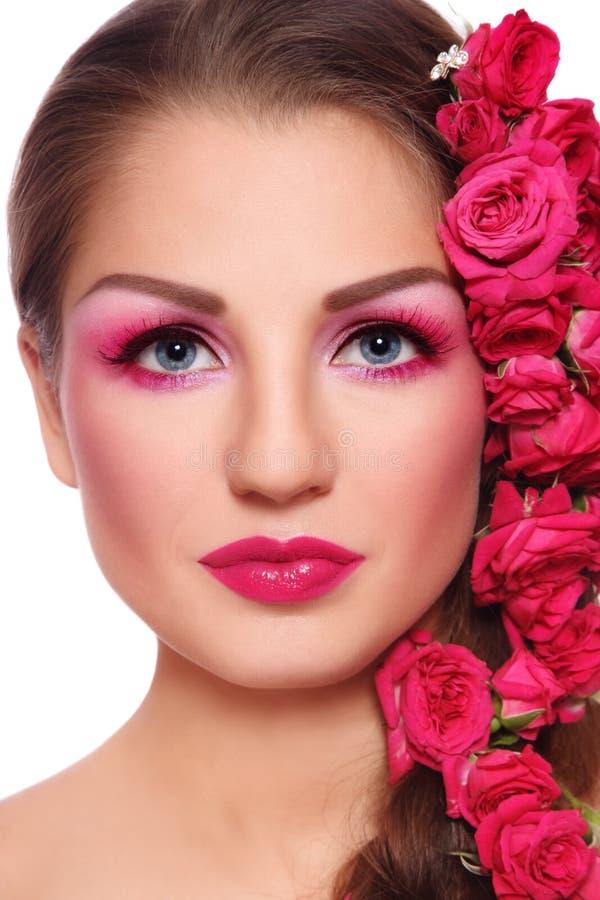 Belleza con las rosas fotos de archivo