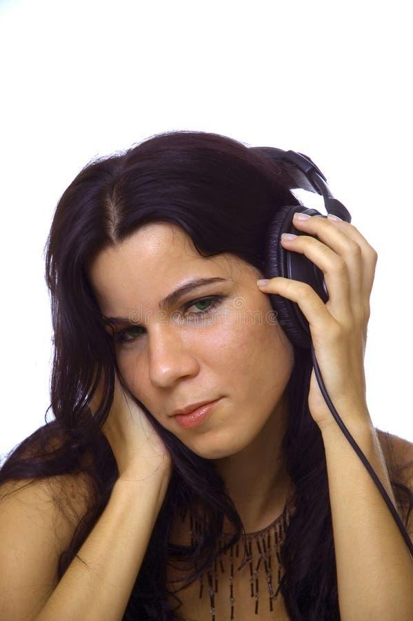 Belleza joven con los auriculares fotos de archivo