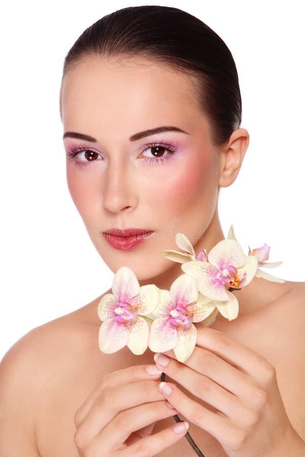 Bellezza con l'orchidea fotografia stock