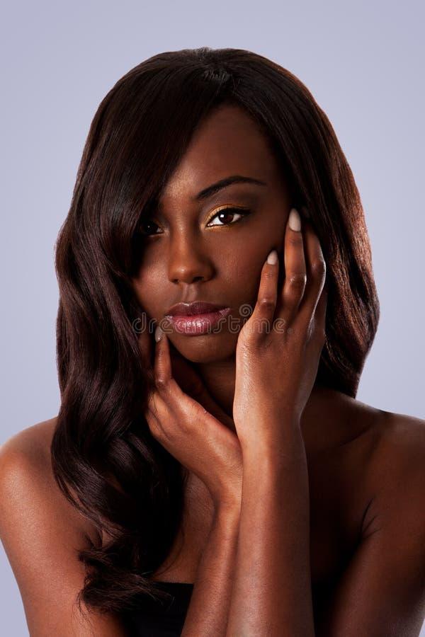 Bellezza nera - fronte femminile fotografia stock