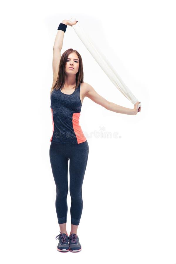 Bello asciugamano della tenuta della donna di forma fisica immagini stock libere da diritti