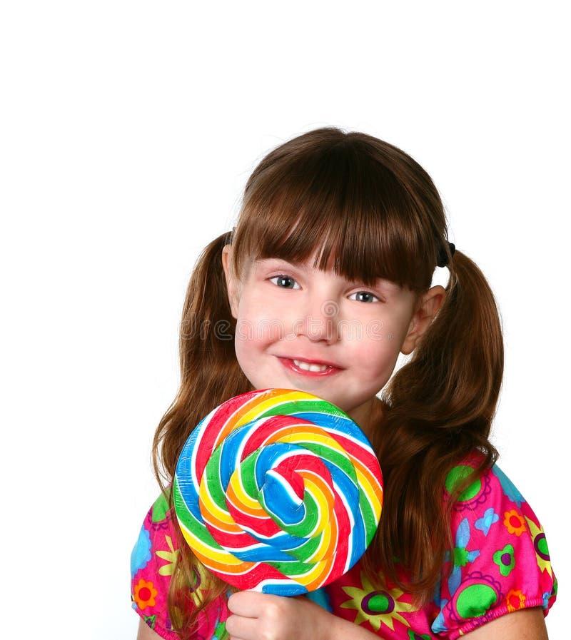 Bello bambino con il Lollipop fotografia stock libera da diritti