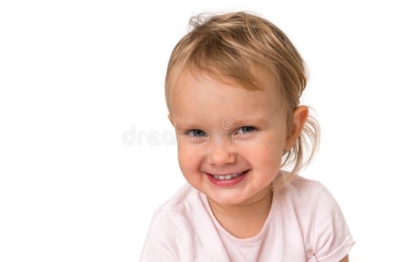 Bello bambino sorridente isolato su fondo bianco fotografie stock