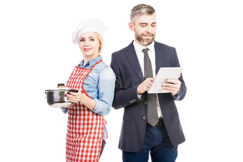 Bello cuoco unico With Busy Husband fotografia stock