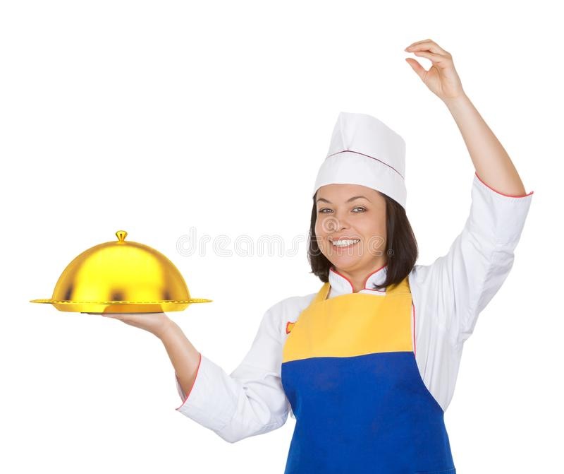 Bello cuoco unico della giovane donna con la campana di vetro dorata del ristorante immagini stock