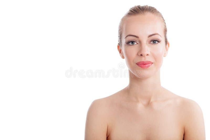 Bello fronte di una donna con pelle pulita - fondo bianco fotografia stock libera da diritti