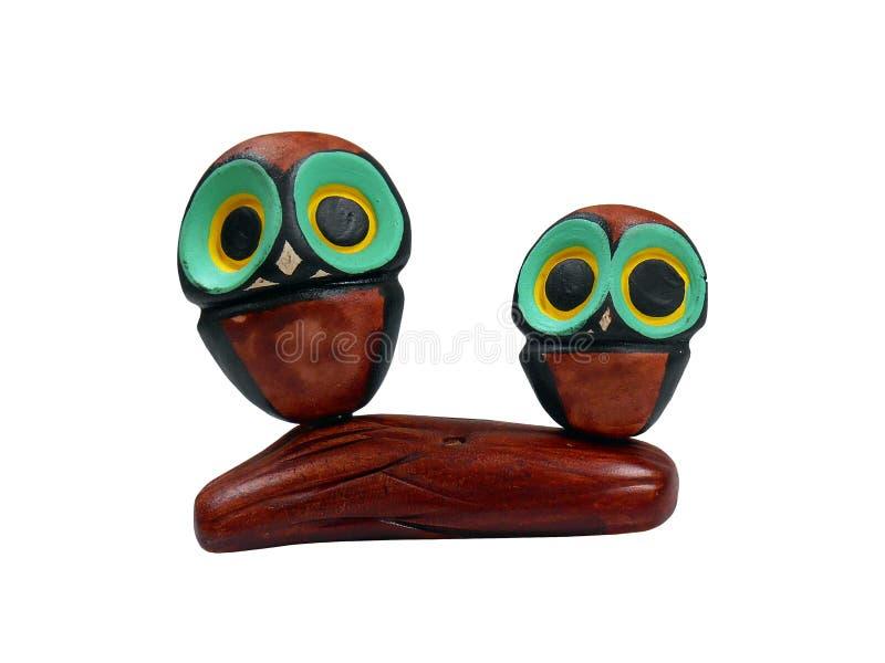 Bello ornamento dei gufi fatti di legno illustrazione di stock