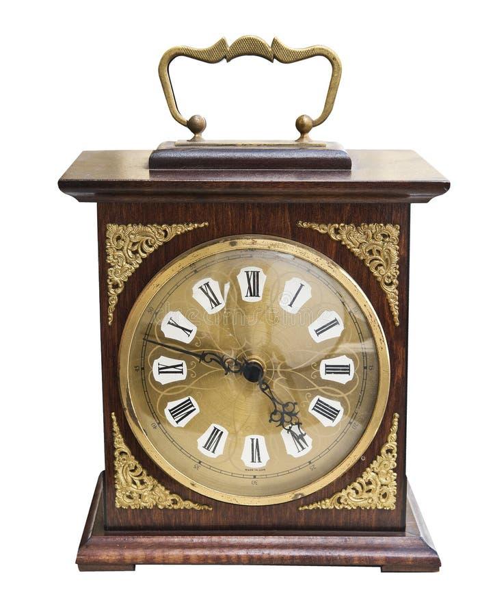Bello orologio d'annata con i gioielli di legno dell'oro e di caso isolati su fondo bianco immagine stock