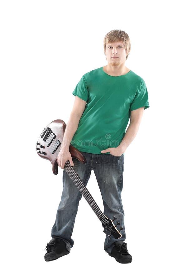 Bello ragazzo con la chitarra elettrica Isolato su bianco fotografie stock