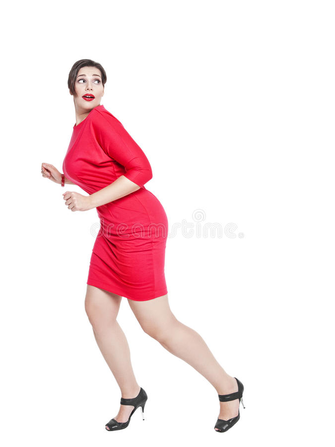 Bello spaventato più la donna di dimensione isolata immagini stock