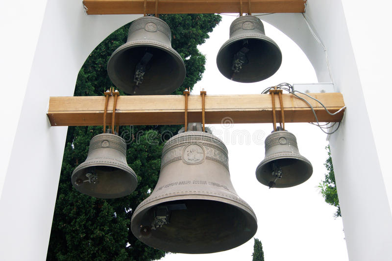 The bells in the church belfry. Five bells of different sizes in the belfry of the church of St. Theodore Ushakov in Herceg Novi, Montenegro royalty free stock photos