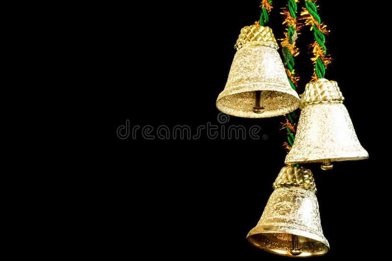Christmas bells on a black background, a musical instrument for the holiday. stock image
