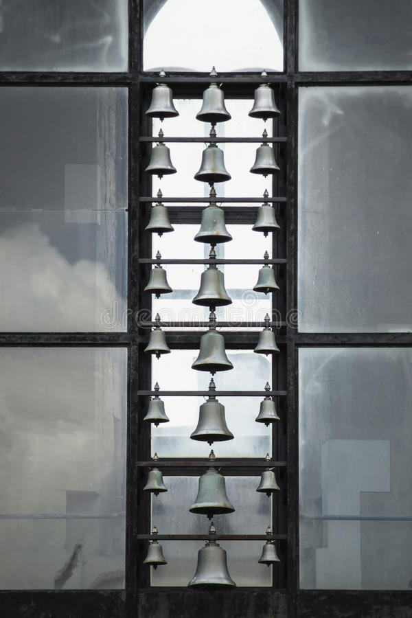 Bells at old church. Bells hanging in vertical row at church ruins in Budapest, Hungary stock image
