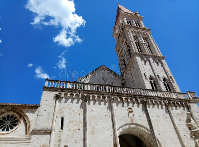Belltower of the Cathedral of St. Lawrence in the downtown of Trogir, Croatia royalty free stock photo