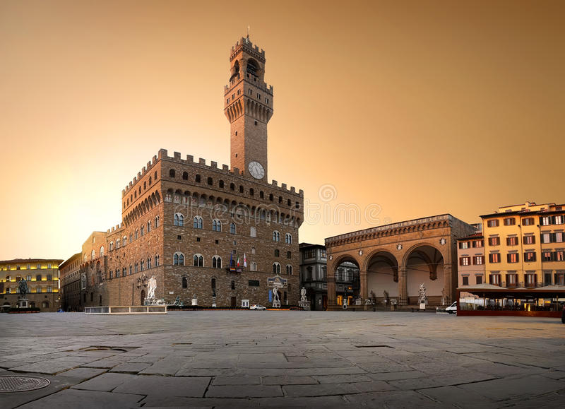 Belltower on piazza. Belltower and the old palace on Piazza della Signoria in Florence, Italy royalty free stock image