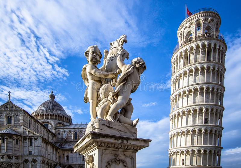 Leaning Tower of Pisa and the Fontana dei Putti, Italy. The Belltower of Pisa, and wonderful medieval monument - the Fontana dei Putti Fountain with Angels with stock image