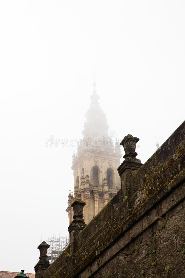 Belltower of the Santiago cathedral. View of the belltower of the Santiago cathedral covered by fog, Spain stock photo