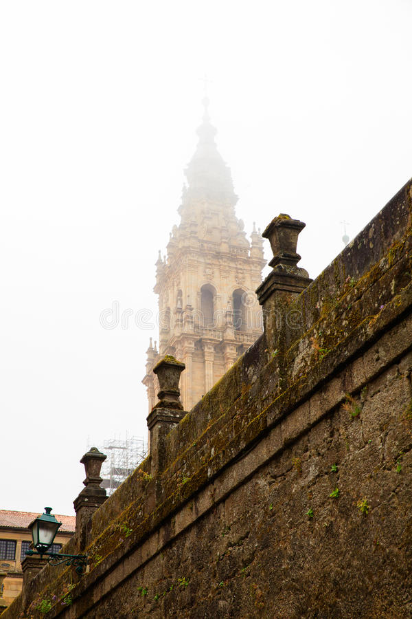 Belltower of the Santiago cathedral. View of the belltower of the Santiago cathedral covered by fog, Spain royalty free stock photography