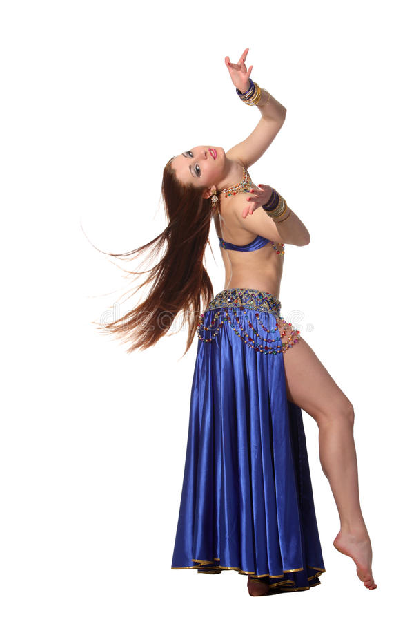 Belly dancer. Young beautiful belly dancer in a blue costume stock photos