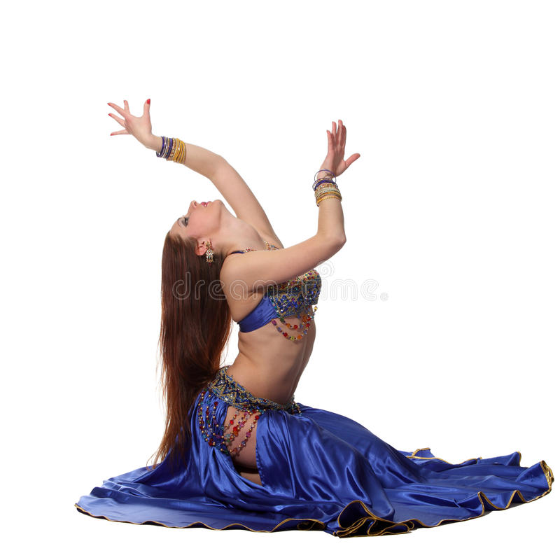 Belly dancer. Young beautiful belly dancer in a blue costume royalty free stock photo