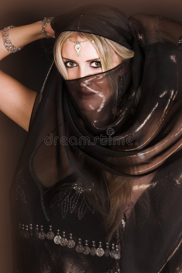 Belly Dancer. Blond Belly Dancer with long hair holding a scarf royalty free stock photography
