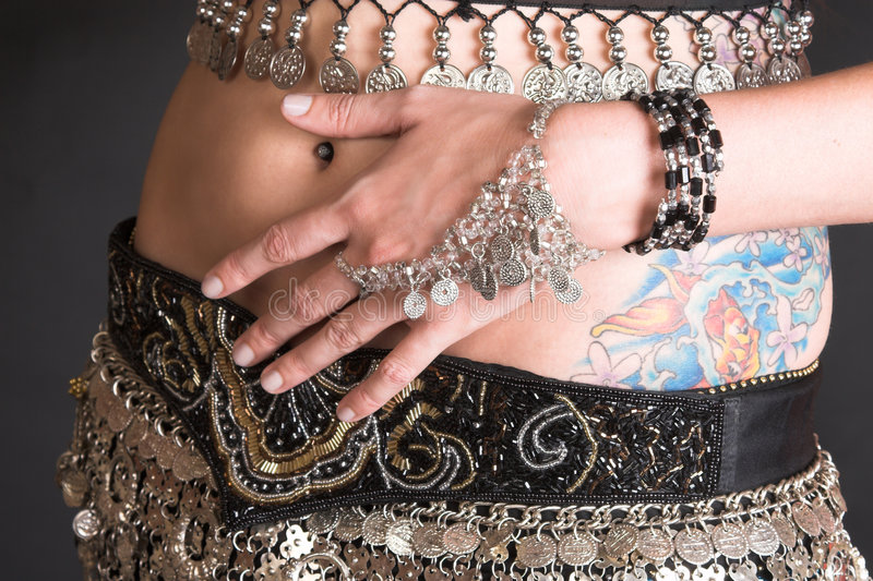 Belly Dancer Body. Belly Dancer with coin decorated costume and jewelery royalty free stock photos