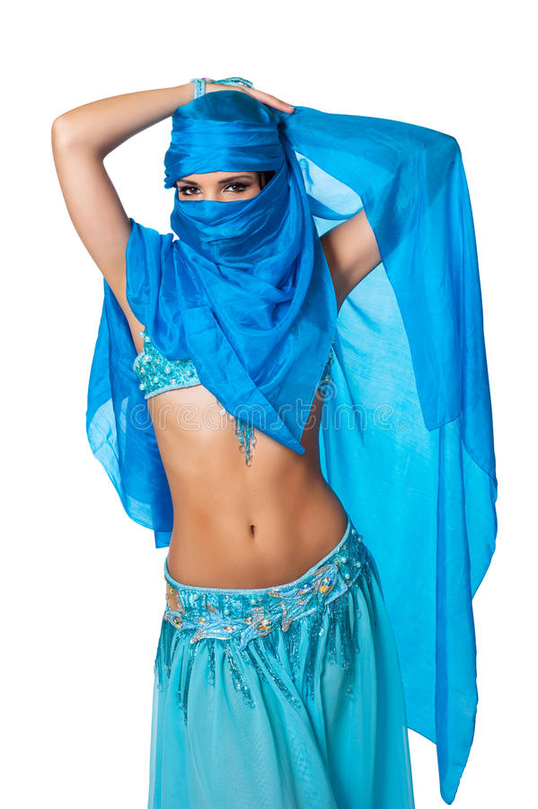 Belly dancer peeking from behind a blue veil. Exotic belly dancer peeking from behind a blue veil wrapped around her head and face. Isolated on white. Clipping royalty free stock images