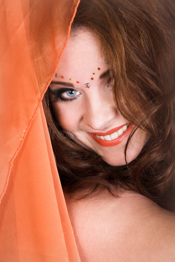 Belly Dancer in Red. Belly Dancer wearing a red costume with jewelery stock images