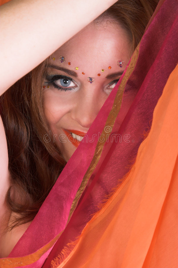 Belly Dancer in Red. Belly Dancer wearing a red costume with jewelery royalty free stock photography