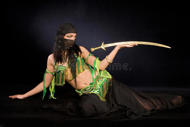 Belly dancer with saber. Oriental belly dancer with saber royalty free stock photo