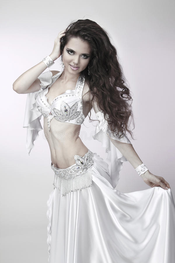 Belly dancer in a white costume stock photo
