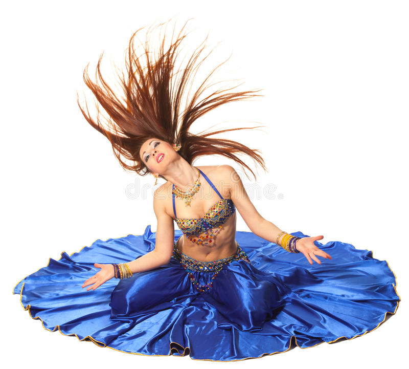 Belly dancer. Young beautiful belly dancer in a blue costume royalty free stock images