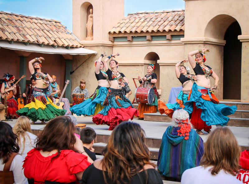 Belly Dancers. A crowd of spectators watching belly dancers` performance of a Spanish-influenced dance at the Renaissance Festival in Phoenix, Arizona stock photo