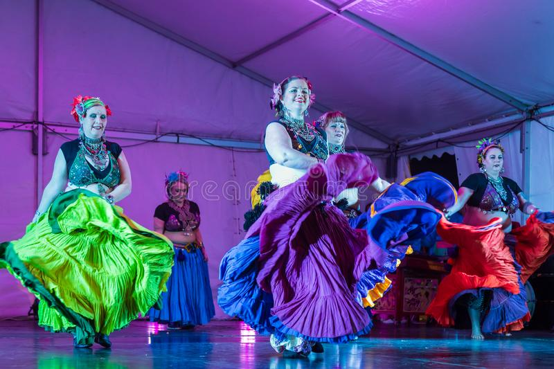 Belly dancers in gypsy costumes dancing on stage royalty free stock photography