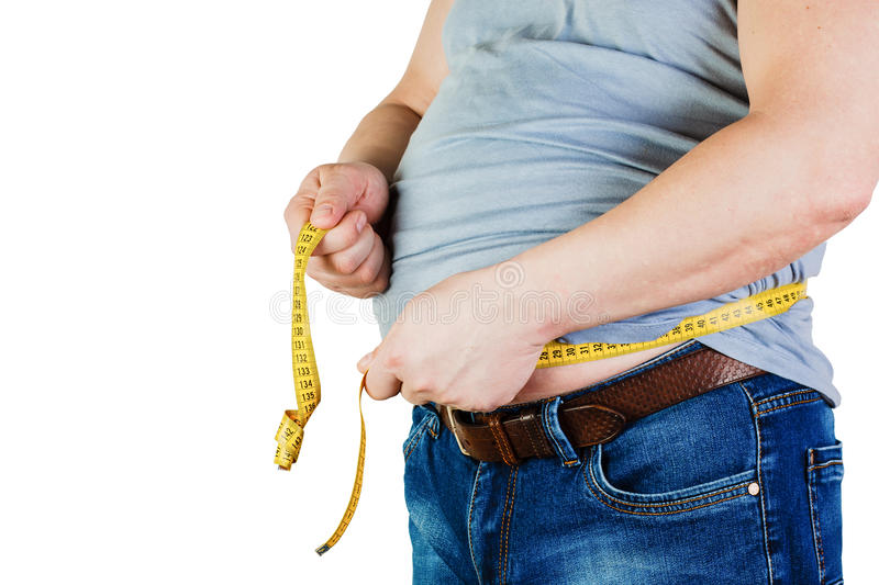 The belly of a fat man isolated on white background. Fat man holding a measuring tape. Weight Loss. stock images