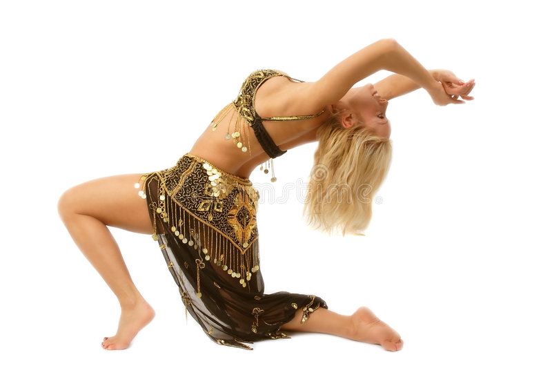 Bellydancer standing on the knee. Beautiful oriental dancer standing on the knee and bending body royalty free stock photography