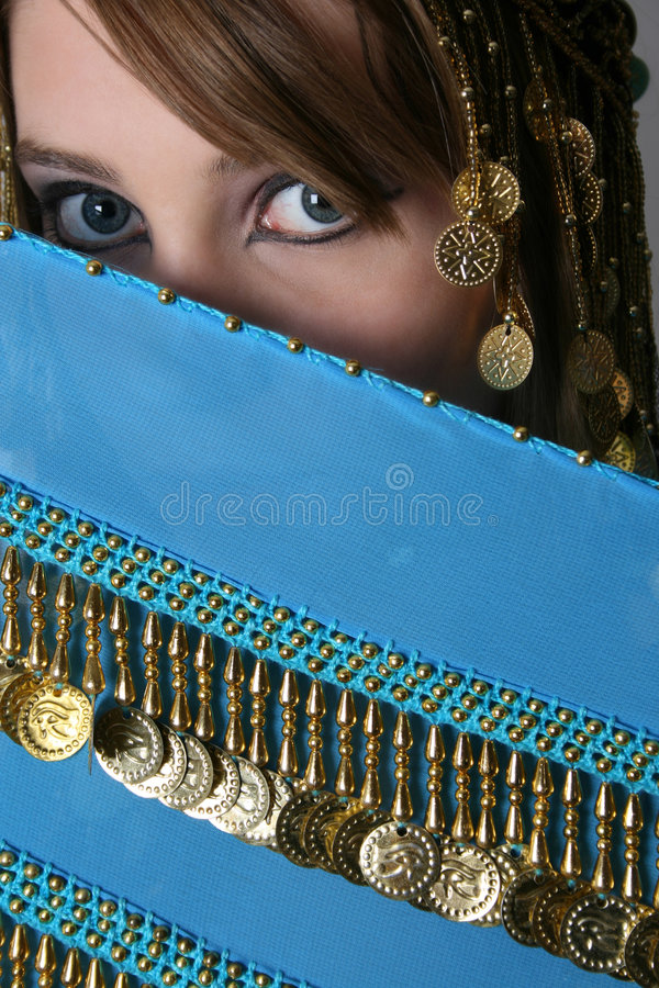 Bellydancing Teen. Beautiful young teenager posing in a belly dance costume royalty free stock images